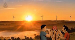Wind turbines on hill with sunrise